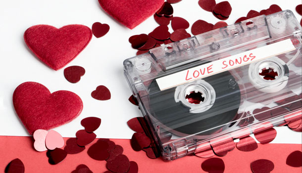 A caseets tape that says Love songs against a background of hearts.